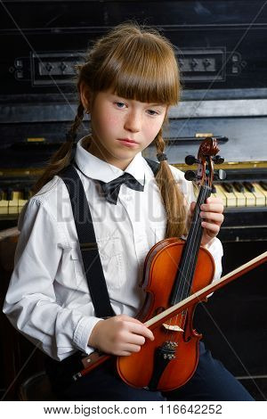 inspired and happy girl holding a violin indoor