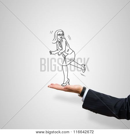 Caricatures of businesswoman in palm