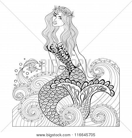 Fantastic mermaid in sea waves with a goldfish and wreath on the