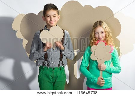 Love concept. Couple of kids. Boy and girl holding a cardboard heart