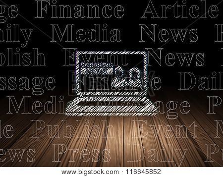 News concept: Breaking News On Laptop in grunge dark room