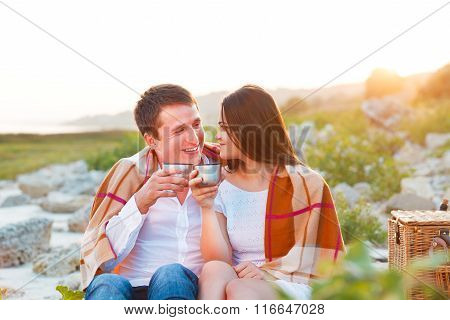 Young Happy Couple In Love At The Summer Picnic