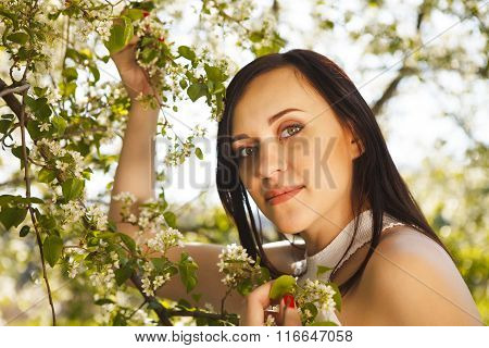 Beautiful Pregnant Woman In White Dress In The Flowering Spring Park