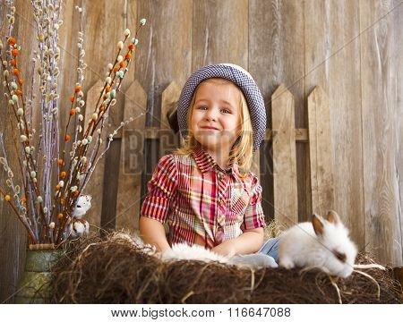 Portrait Of An Adorable Little Girl And Little White Rabbit. Easter Concept