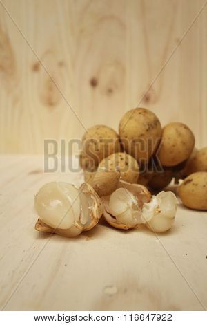Longkongs On A Background Of Brown Wood.