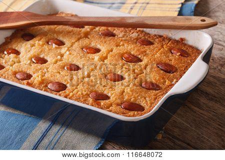 Namoora With Almonds Close Up In Baking Dish. Horizontal