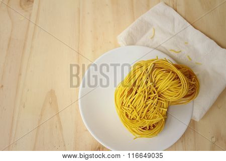 Noodles On A Background Of Brown Wooden.