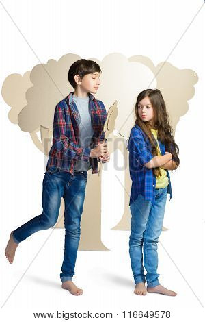 Love concept. Couple of kids. boy gives a girl cardboard flowers isolate on white