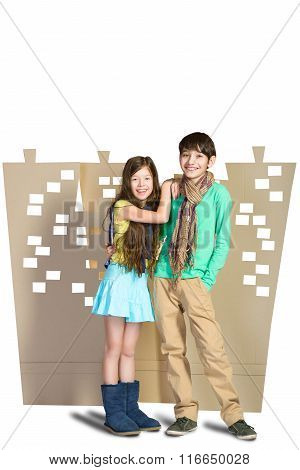 Love concept. Stylish boy and girl hugging each other on background of cardboard city