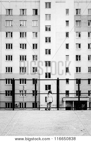 Young Girl And Tower Block Apartments