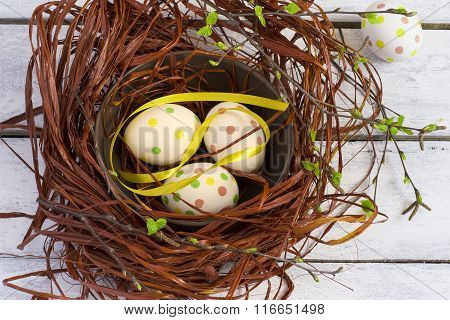 Easter Background With Colored Eggs In The Nest And White Boards