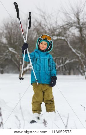 The boy in a blue jacket on skiing outdoor winter day