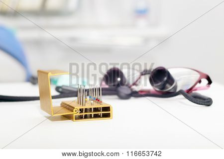 Set Of Dentist Drills And Eyeglasses