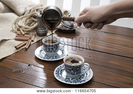 Female Hand Pouring Turkish Coffee