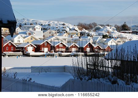 Boathouses in snow