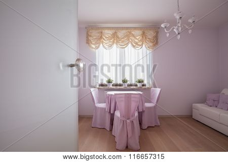 Table And Covered Chairs
