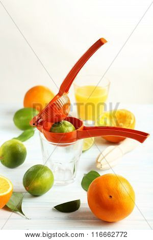 Juicer And Orange On A Wooden Table
