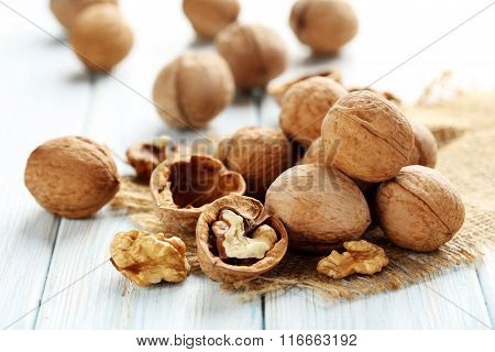 Walnuts On A Blue Wooden Table