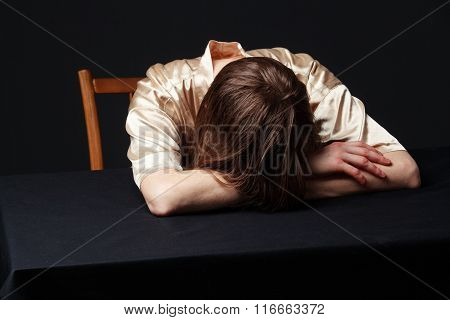 Despair. Woman Is Lying On The Table, Head On The Hands