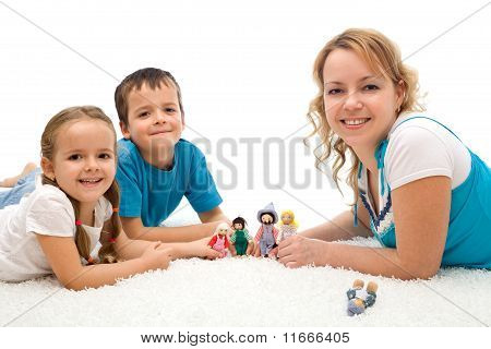 Happy Woman And Kids Playing On The Floor With Puppets