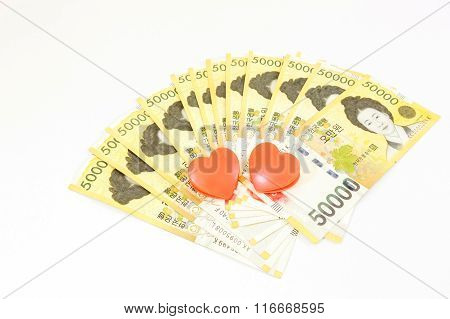 Korea Money With Twin Heart On White Background