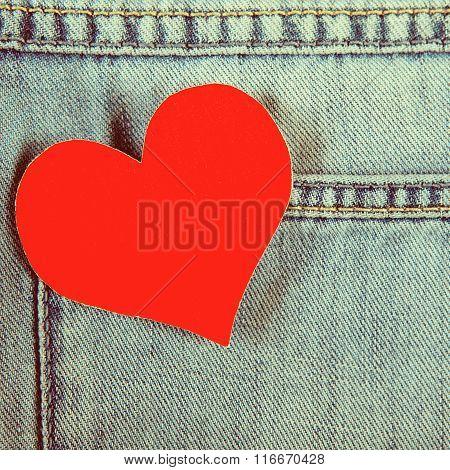Heart On Denim Background