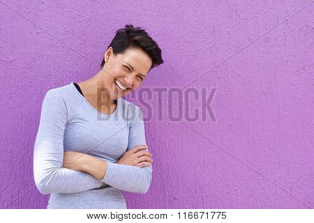 Young Woman Laughing With Arms Crossed