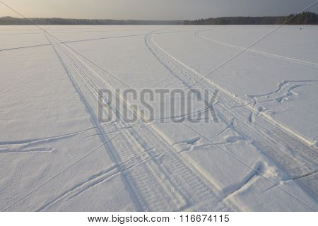 Snowmobile Traces On The Lake
