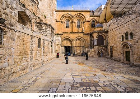 JERUSALEM, ISRAEL - FEBRUARY 23, 2012: Visitors at the Church of the Holy Sepulcure entrance in Jerusalem. The church is the site where Jesus was crucified and resurrected according to Christendom.
