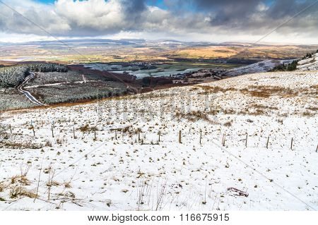 Light Snow Over Fields, Hills And Trees.  Vale Of Neath, South Wales, United Kingdom.