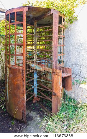 Old Derelict Disused Coin Operated Turnstile.
