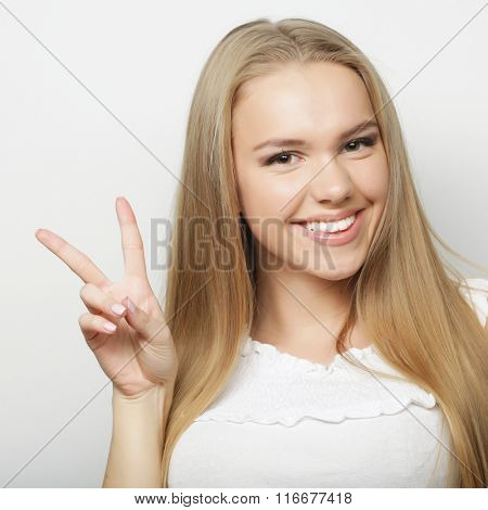 lovely woman showing victory or peace sign