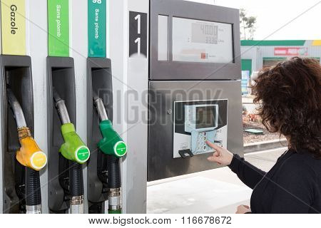 Petrol Station. Filling Station. Gasoline. Woman Close To Petrol Tap