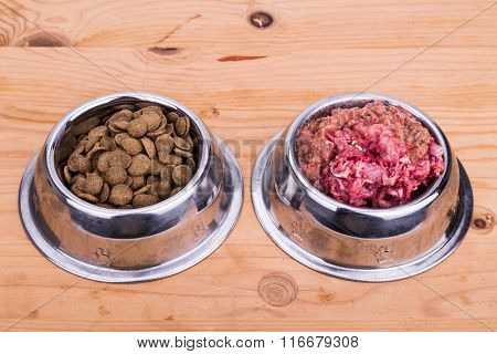 Choice Of Raw Meat Or Dried Pellets Dog Food In Bowl