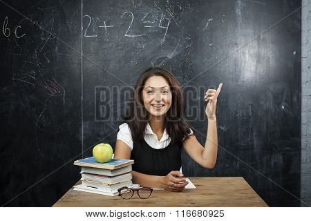young cute tanned teenage girl happy pointing, thinking, education concept