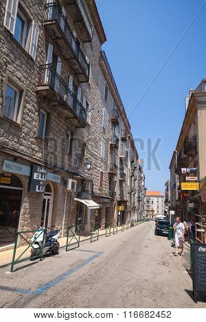 Street View With Walking Ordinary People. Sartene Town