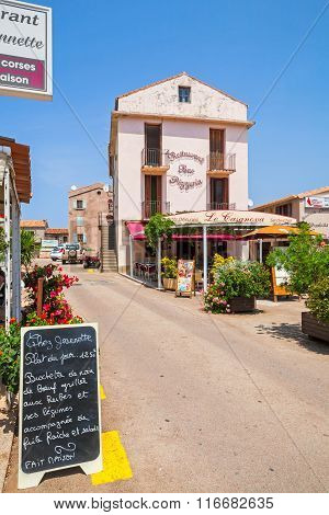 Small Corsican Town Street View With Pizzeria Facade