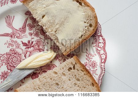 Tasty Buttered Bread On The Vintage Plate