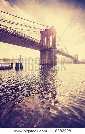 Vintage Stylized Manhattan Bridge Against Sun, Nyc, Usa.