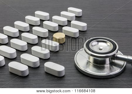Phonendoscope and pill on the table, concept