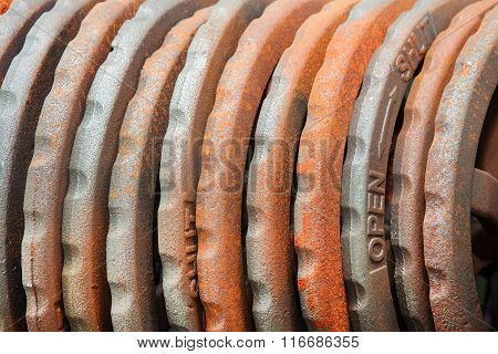 Steel rusted hand wheels in warehouse