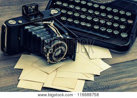Vintage Photo Camera And Typewriter. Retro Toned