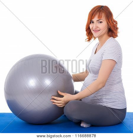 Young Beautiful Pregnant Woman Doing Exercises With Fitball Isolated On White