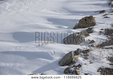 Snowdrift Rocks And Shadows