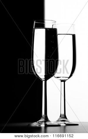 Transparent Two Glasses with liquid on black and white background