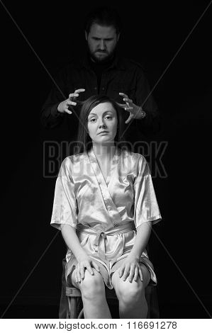 Sad Woman Is Sitting On The Chair, , Man's Figure  Behind Threaten Her