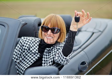 Middleaged Woman With Her New Convertible
