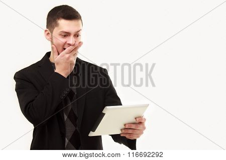 Surprized Businessman With Tablet