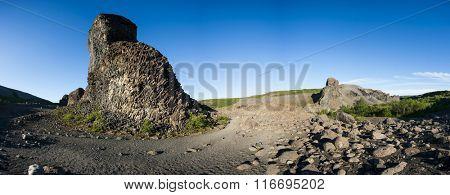Beautiful rocks made of hexagonal basalt rosettes in Icelandic national park Jokulsargljufur, Hljodaklettar Area. Panoramic photo