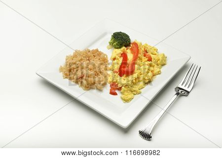 Scrambled eggs with rice.